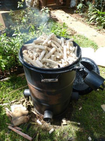 A loaded kinyanjui type barrel kiln carbonizing maize cobs