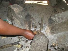 Lighting a 3 stone fire with Palm Wastes